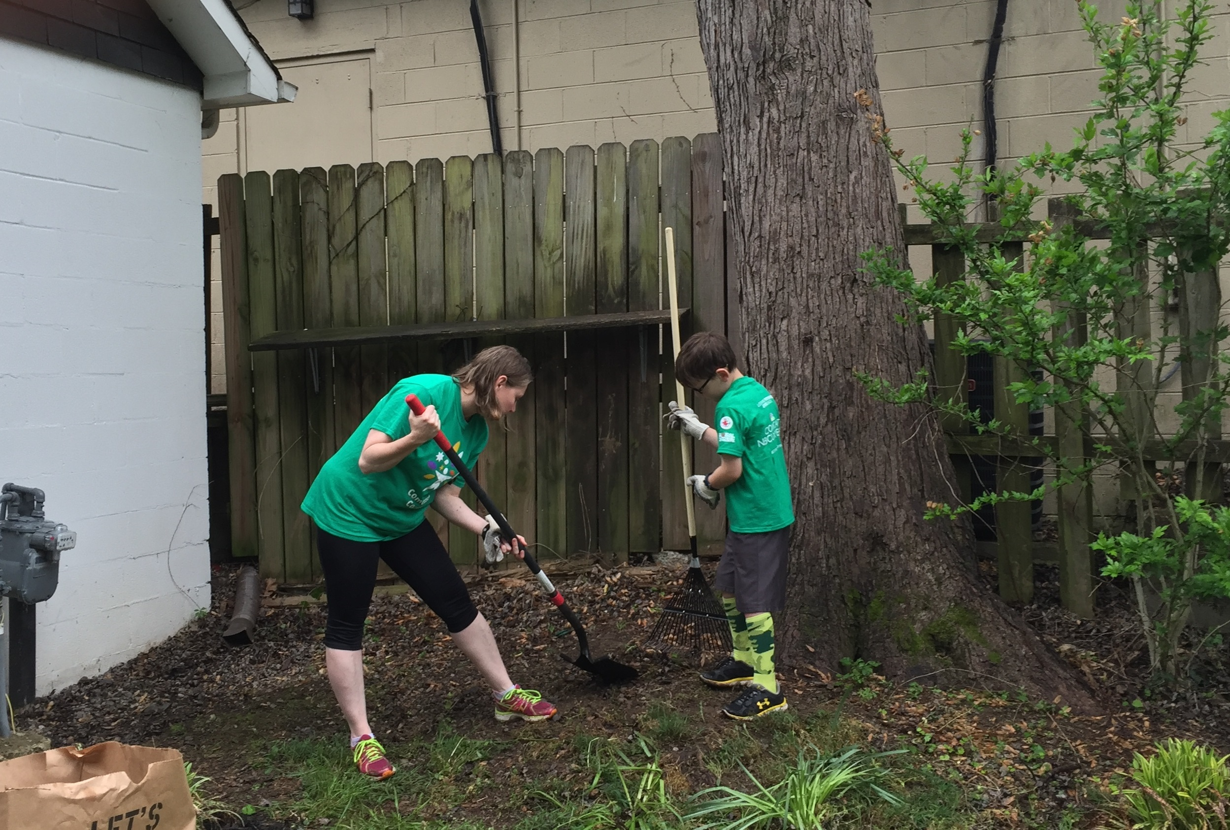 Comcast Employee Kim Sasser Hayden and her son help spruce up the JL Clay Center for the 15th Comcast Cares Day volunteer project in Franklin.jpg