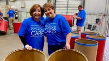 Comcast Cares Day volunteers sort food donations.